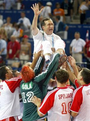 Cro handball triumph in Athens, 2004, Lino Cervar on hands of his team (AP Photo/Alastair Grant)